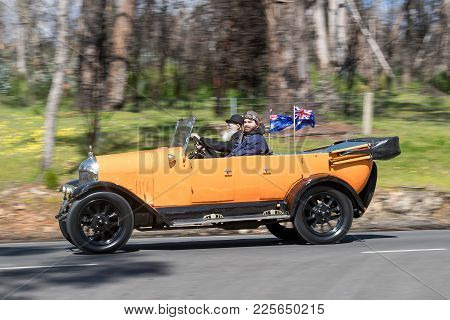 Adelaide, Australia - September 25, 2016: Vintage 1926 Morris Cowley Tourer driving on country roads near the town of Birdwood, South Australia.