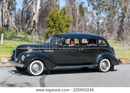 Adelaide, Australia - September 25, 2016: Vintage 1939 Dodge D11 Sedan driving on country roads near the town of Birdwood, South Australia.