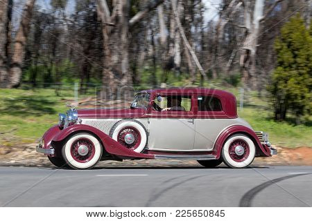 Adelaide, Australia - September 25, 2016: Vintage 1933 Lincoln Ka Victoria Coupe Driving On Country