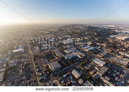 Long Beach, California, USA - January 11, 2018:  Foggy afternoon aerial view of buildings and streets near Signal Hill.