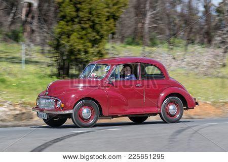 Adelaide, Australia - September 25, 2016: Vintage 1950 Morris Lolite Minor Saloon Driving On Country