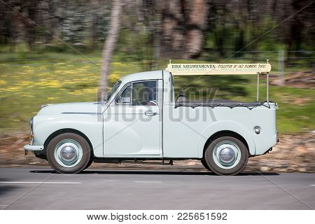 Adelaide, Australia - September 25, 2016: Vintage 1953 Morris Minor Utility Driving On Country Roads