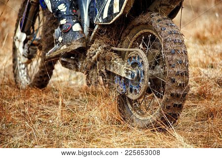 Dirty Wheel Of A Crossover Motorcycle . Wheel After Motorcycle Racing