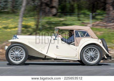 Adelaide, Australia - September 25, 2016: Vintage 1949 Mg Tc Roadster Driving On Country Roads Near