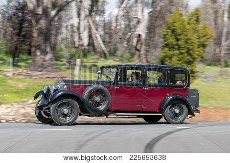 Adelaide, Australia - September 25, 2016: Vintage 1930 Buick 6 Cylinder Sedan Driving On Country Roa
