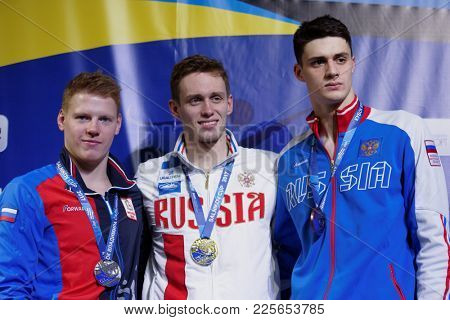 ST. PETERSBURG, RUSSIA - DECEMBER 22, 2017: Winners of XI Salnikov Cup in 200 m breaststroke swimming Kirill Prigoda (center), Mikhail Dorinov (left) and Rustam Gadirov, all from Russia