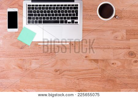 Business Working At An Office, Modern Office Desk Table With Laptop Computer, Smartphone, And Cup Of