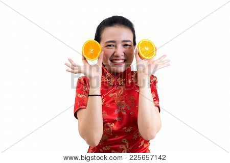 Portrait Of Asian Woman In Traditional Chinese Long Dress, Cheongsam, Presenting Oranges On Hand For