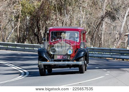 Adelaide, Australia - September 25, 2016: Vintage 1925 Rolls Royce Phantom 1 Limosine Driving On Cou