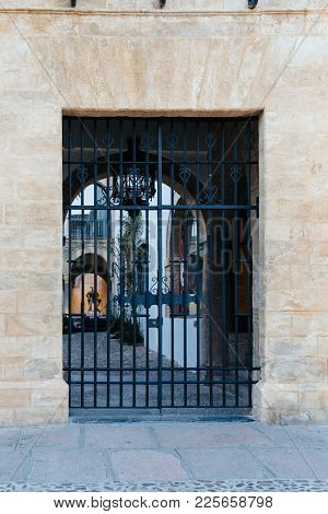 Cordoba, Spain - April 10, 2017: Entrance To Old Typical Courtyard Or Patio In The Jewish Quarter Of