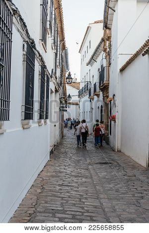 Cordoba, Spain - April 10, 2017: Old Typical Street In The Jewish Quarter Of Cordoba With White Wall