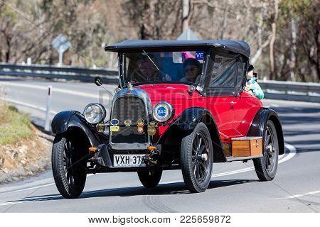 Adelaide, Australia - September 25, 2016: Vintage 1927 Willys Whippet 96 Roadster Driving On Country