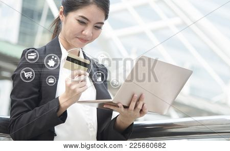 Businesswoman Using Computer And Credit Card For Internet Banking. E-commerce Internet Technology Co