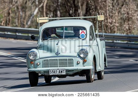 Adelaide, Australia - September 25, 2016: Vintage 1953 Morris Minor Utility (ute) Driving On Country