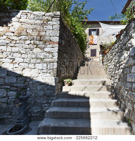 Staircase As A Narrow Passage Between Old Houses In Tuscany. Stairways At The Ancient Part Of Old Ci
