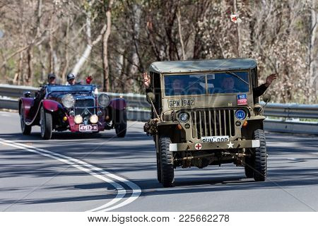 Adelaide, Australia - September 25, 2016: Vintage 1942 Willys Jeep Utility Driving On Country Roads