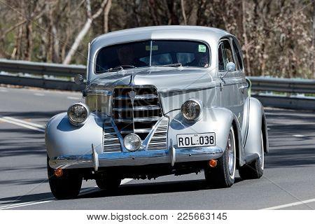 Adelaide, Australia - September 25, 2016: Vintage Oldsmobile Driving On Country Roads Near The Town