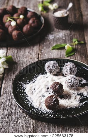 Homemade Healthy Vegan Chocolate Balls, Truffles, Candies Sprinkled Grated Coconut In The Plate On T
