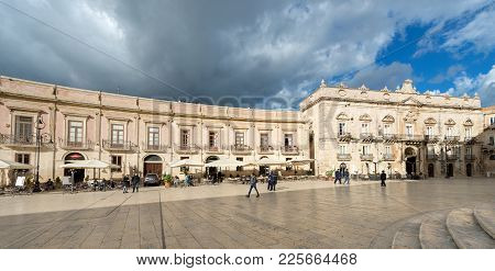 Ortygia Island, Syracuse, Italy - Dec 9, 2017: Tourists And Locals Visit The Cathedral Square (piazz