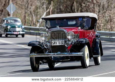 Adelaide, Australia - September 25, 2016: Vintage 1932 Chevrolet Confederate Sports Roadster  Drivin