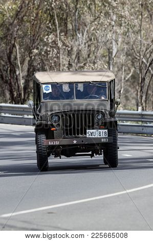 Adelaide, Australia - September 25, 2016: Vintage 1944 Willys Jeep Utility Driving On Country Roads