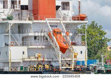 Labuan,malaysia-feb 2,2018:free Fall Life Boat For Emergency Crew Evacuation Installed On Cargo Ship