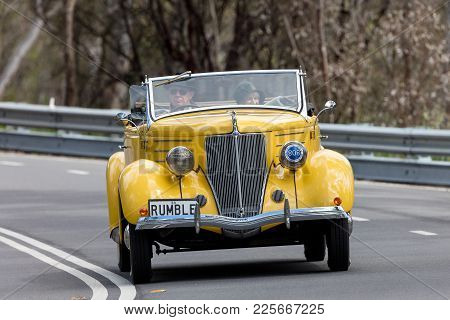 Adelaide, Australia - September 25, 2016: Vintage 1936 Ford Roadster Tourer Driving On Country Roads