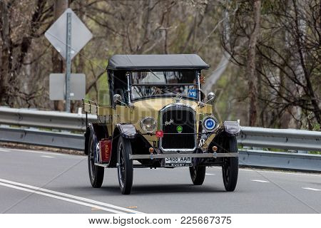 Adelaide, Australia - September 25, 2016: Vintage 1924 Rugby F Utility Driving On Country Roads Near