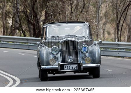 Adelaide, Australia - September 25, 2016: Vintage 1954 Bentley R Type Saloon Driving On Country Road