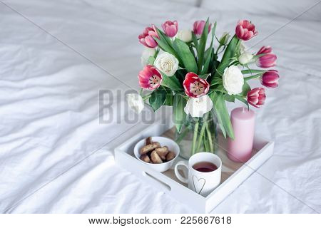 Romantic Breakfast In Bed. Bouquet Of Flowers. Roses And Tulips. Spring. Valentine's Day. Internatio