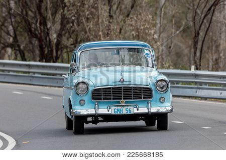 Adelaide, Australia - September 25, 2016: Vintage 1956 Holden Fe Sedan Driving On Country Roads Near