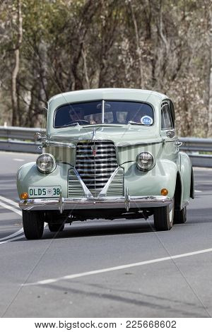 Adelaide, Australia - September 25, 2016: Vintage 1938 Oldsmobile F38 Coupe Driving On Country Roads