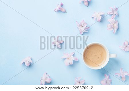 Creative Composition With Morning Coffee And Pink Flowers On Blue Pastel Background Top View. Flat L