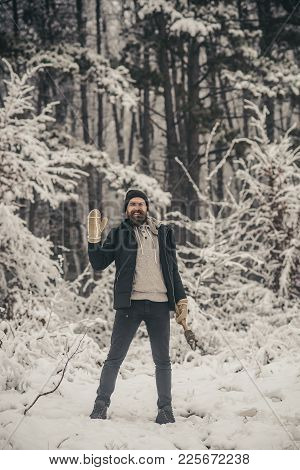 Camping, Traveling And Winter Rest. Bearded Man With Axe In Snowy Forest. Skincare And Beard Care In