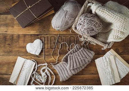 Light Gray Knits In A Basket And Knitting Needles, A White Knitted Scarf, A Heart. Set With White Ri