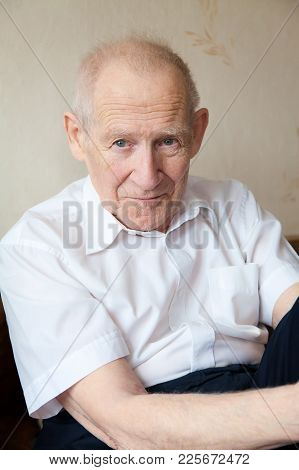Face Portrait Of An Old Man In White Shirt