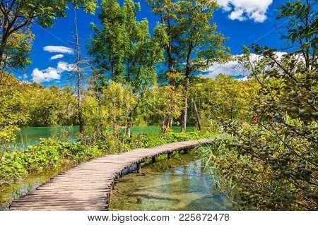 Beautiful Walking Path Through The Lake In The Plitvice National Park, Croatia
