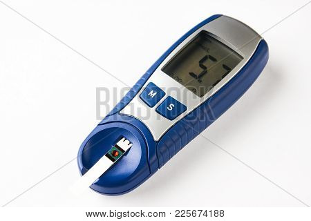 Blood Sugar Test Isolated On White Background With Copy Space. Glucose Meter With Blood Sugar Level