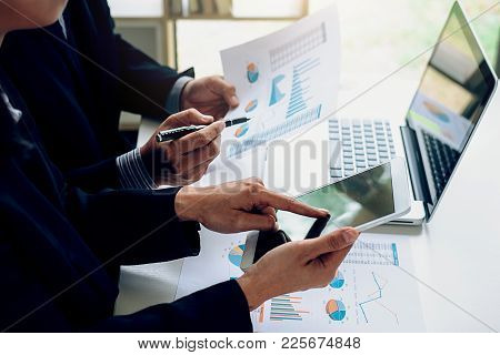 Business Working At Office With Laptop, Smartphone And Documents On His Desk. Business Concept.