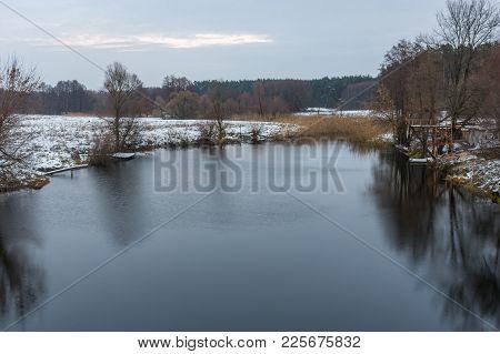 Pictorial Evening Landscape With Small River Hrun At Winter Season In Poltavskaya Oblast, Ukraine