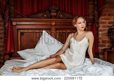 Young Woman Wearing White Silk Night Lingerie