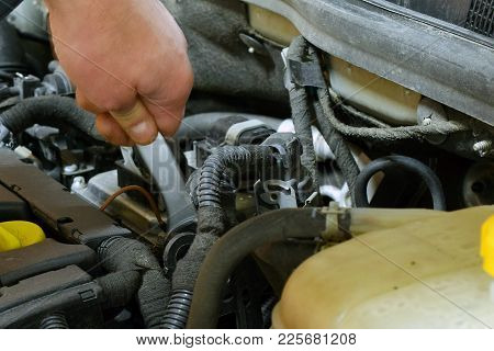 Auto Mechanic Repairs Car. Hand With Pen-end Wrench.