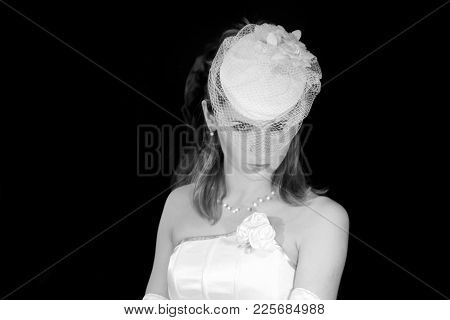 Bride In Wedding Hat Veil, Bridal Fashion Portrait, Beautiful Woman Looking At Camera Over Black Bac