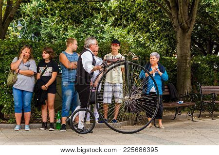 Debrecen, Hungary - August 20, 2017: A Group Of Spectators Viewing Penny-farthing During The 48th Fl