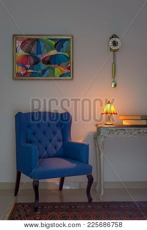 Vintage Furniture: Interior Composition Of Blue Armchair, Vintage Wooden Beige Table, Illuminated Ta