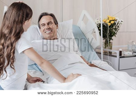 I Believe In You Daddy. Selective Focus On A Radiant Gentleman Lying In A Hospital Bed And Grinning
