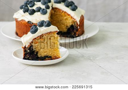 Sour Cream Blueberry Cake Served On A Plate On A White Stone Background