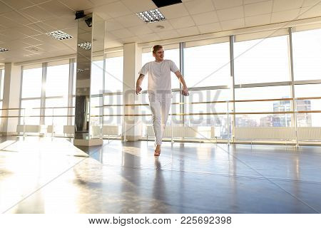 Novice Dancer Waiting Trainer Fooling, Tattooed Boy Hopping Waving Hands. Fair-haired Young Man With