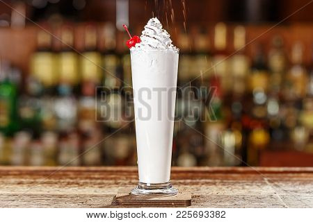 Liquor, Ice Cream And Cream In A Blender With Half A Cup Of Crushed Ice, Mixed Until Smooth. Space F
