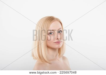 Beautifull Women Face With Healthy Skin On White Background. Young Blonde With Nude Makeup. Beuaty F
